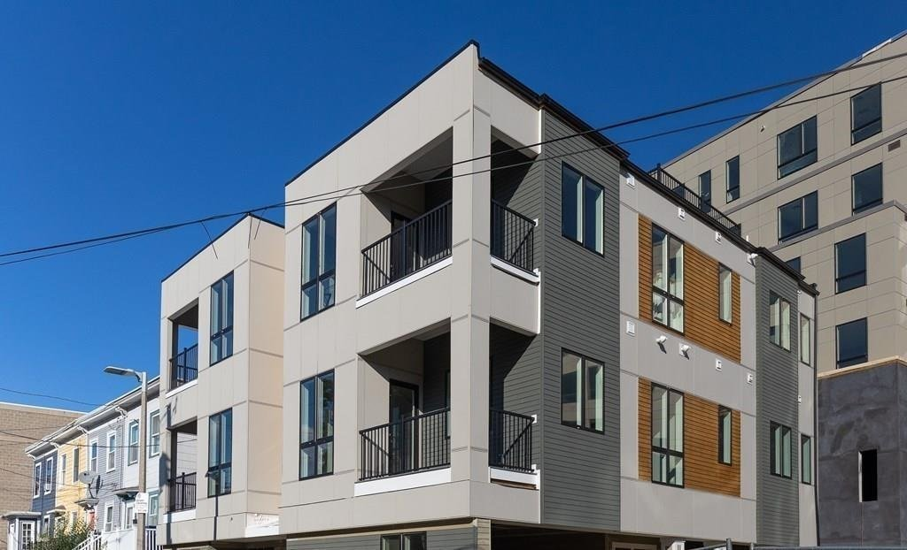 The first five of an eight-unit condo association on Haverford Street in Jamaica Plain